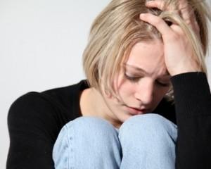 Girl experiencing PMS symptoms